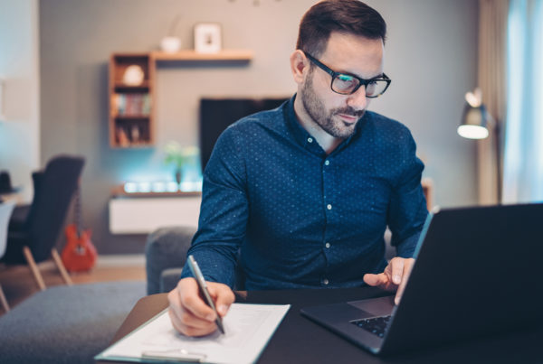 Businessman using laptop to look at dividends