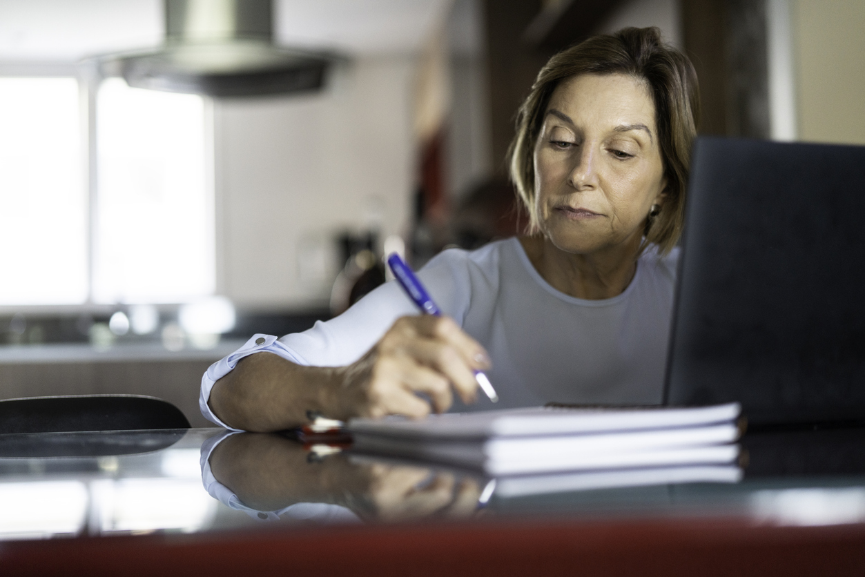 Mature woman writing a Will