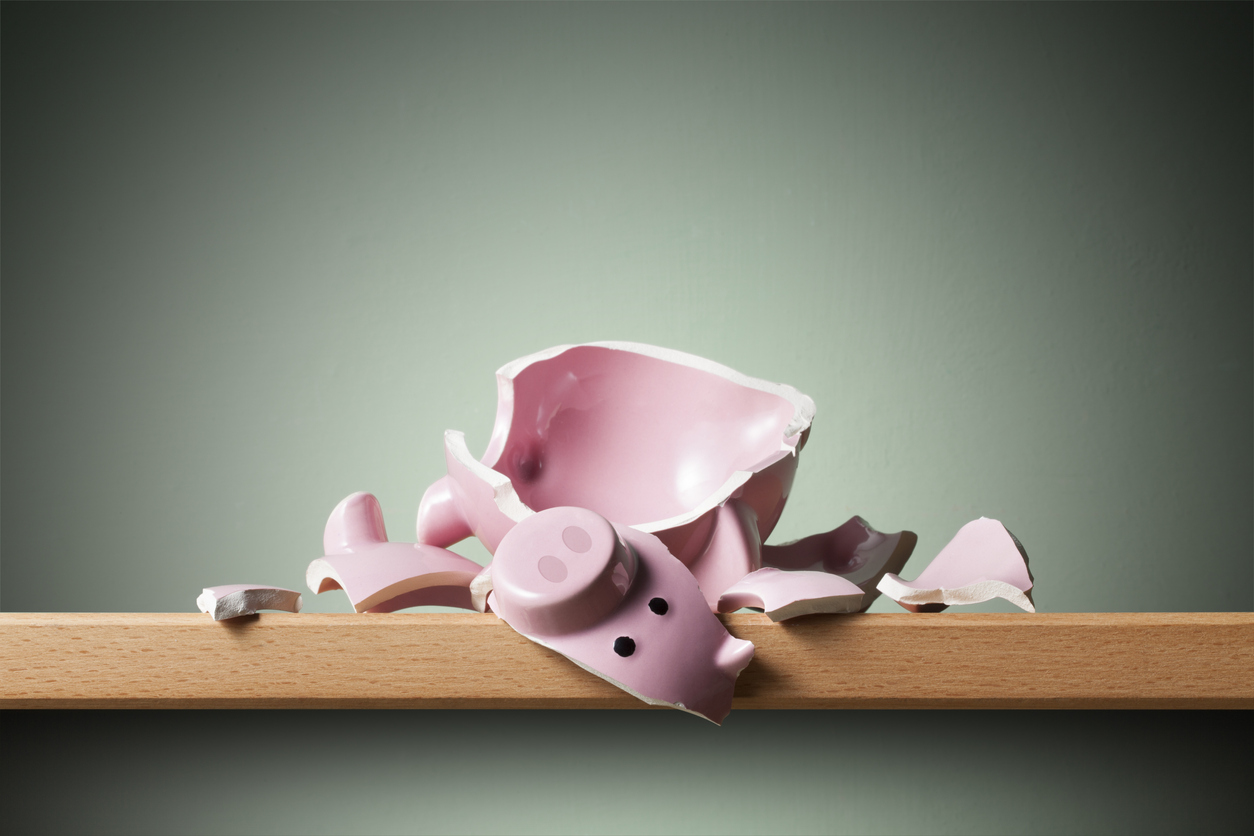 Broken piggy bank on the shelf. National Savings