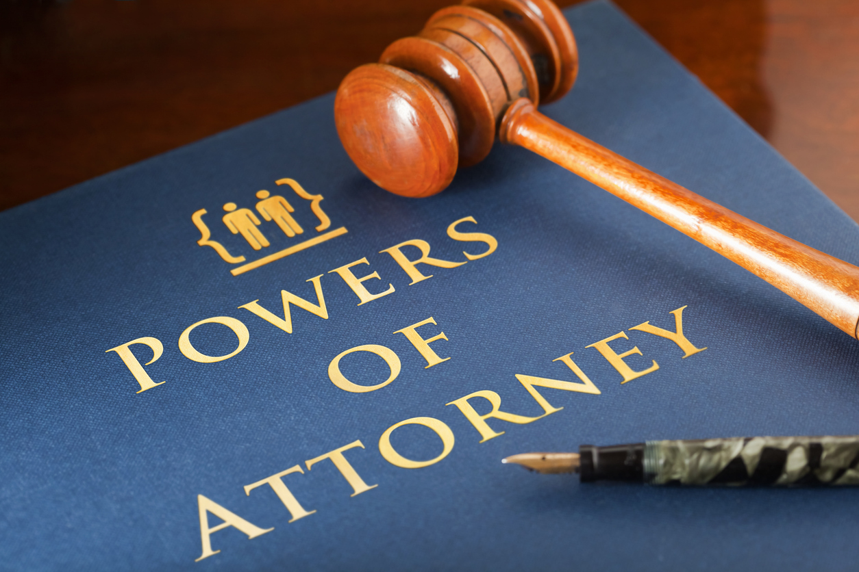 Gavel laying across book entitled Powers of Attorney