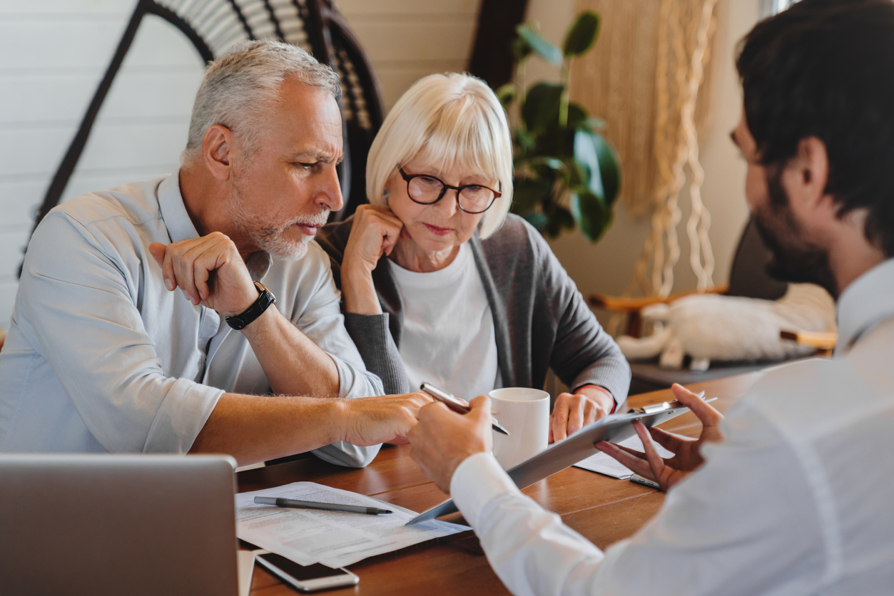 Senior couple receiving independent financial advice