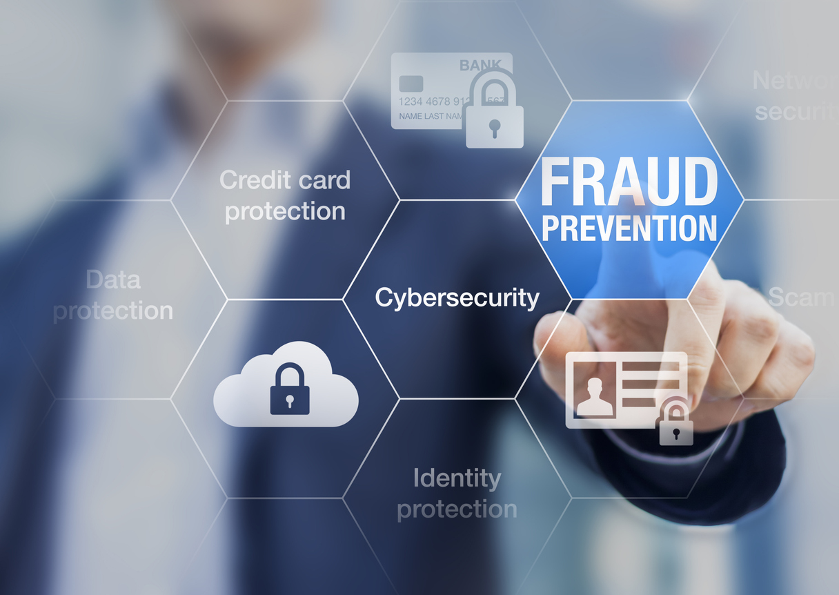 Businessman clicking on fraud prevention button