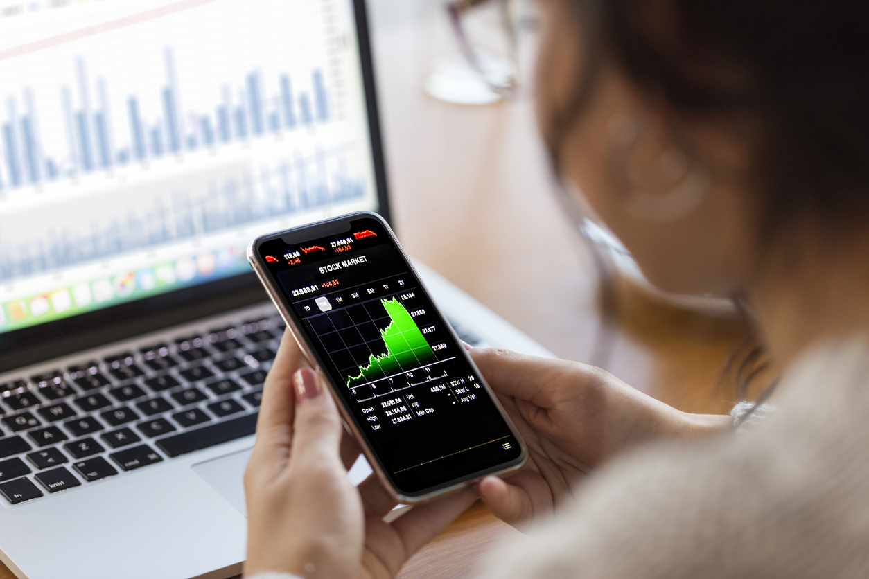 Woman looking at investment figures on her mobile phone